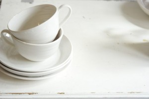 White cups on white wood
